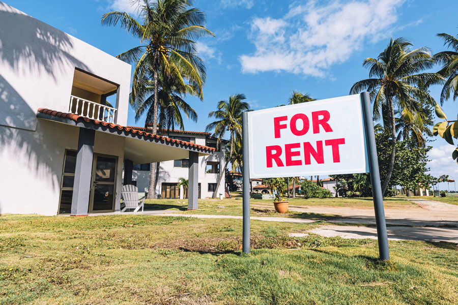 For Rent sign in front of apartment complex